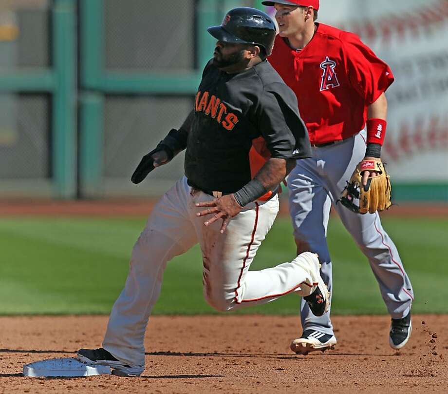 Giants third baseman Pablo Sandoval rounds second base to score on a fourth-inning double. Photo: Lance Iversen, The Chronicle
