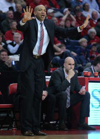 Fairfield University mens basketball coach Sydney Johnson talks to his team during game action against the University of Albany Saturday, Feb. 23, 2013 at the Webster Bank Arena in Bridgeport, Conn. Photo: Autumn Driscoll / Connecticut Post