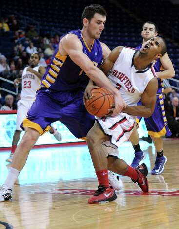 Fairfield's Derek Needham is fouled by Albany's Sam Rowley Saturday, Feb. 23, 2013 at the Webster Bank Arena in Bridgeport, Conn. Photo: Autumn Driscoll / Connecticut Post