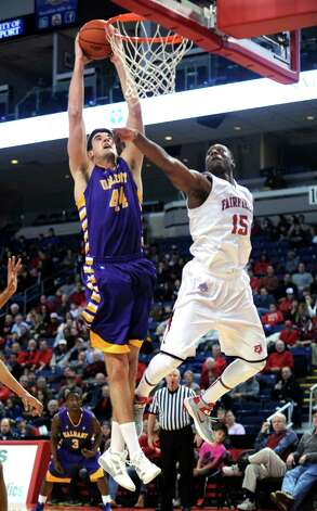 Albany's John Puk puts up the ball as Fairfield's Maurice Barrow defends Saturday, Feb. 23, 2013 at the Webster Bank Arena in Bridgeport, Conn. Photo: Autumn Driscoll / Connecticut Post