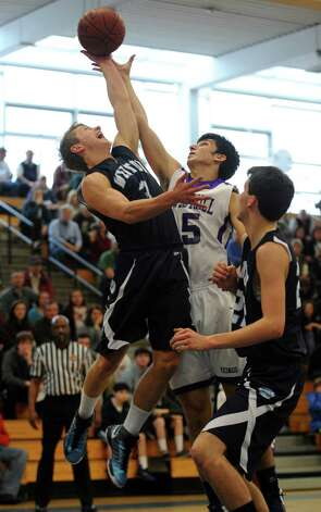 Wilton's Max Maudsley and Westhill's Evan Shoparantzas go for the rebound during the FCIAC boys' basketball quarterfinals Saturday, Feb. 23, 2013 at Fairfield Ludlowe High School in Fairfield, Conn. Photo: Autumn Driscoll / Connecticut Post