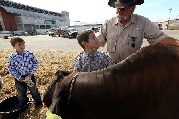 David Jalufka, 62, visited the San Antonio Stock Show & Rodeo recently with grandsons Rancher Jalufka, 7, left, and Utah Jalufka, 9.