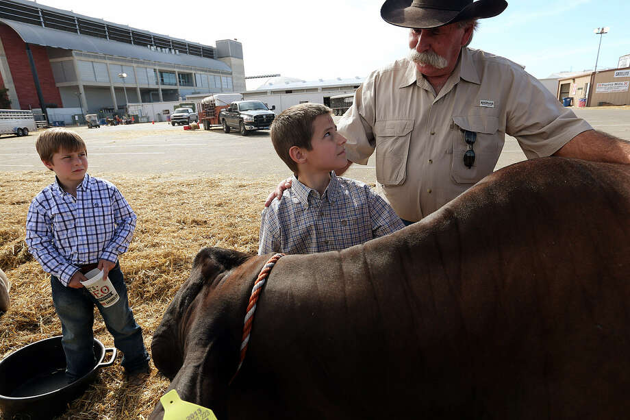 David Jalufka, 62, visited the San Antonio Stock Show & Rodeo recently with grandsons Rancher Jalufka, 7, left, and Utah Jalufka, 9. Photo: Jerry Lara / San Antonio Express-News