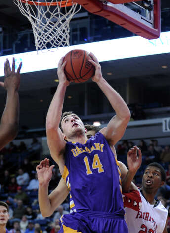 Albany's Sam Rowley puts up the ball during game action against Fairfield University Saturday, Feb. 23, 2013 at the Webster Bank Arena in Bridgeport, Conn. Photo: Autumn Driscoll / Connecticut Post