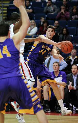 Albany's John Puk passes the ball during game action against Fairfield University Saturday, Feb. 23, 2013 at the Webster Bank Arena in Bridgeport, Conn. Photo: Autumn Driscoll / Connecticut Post