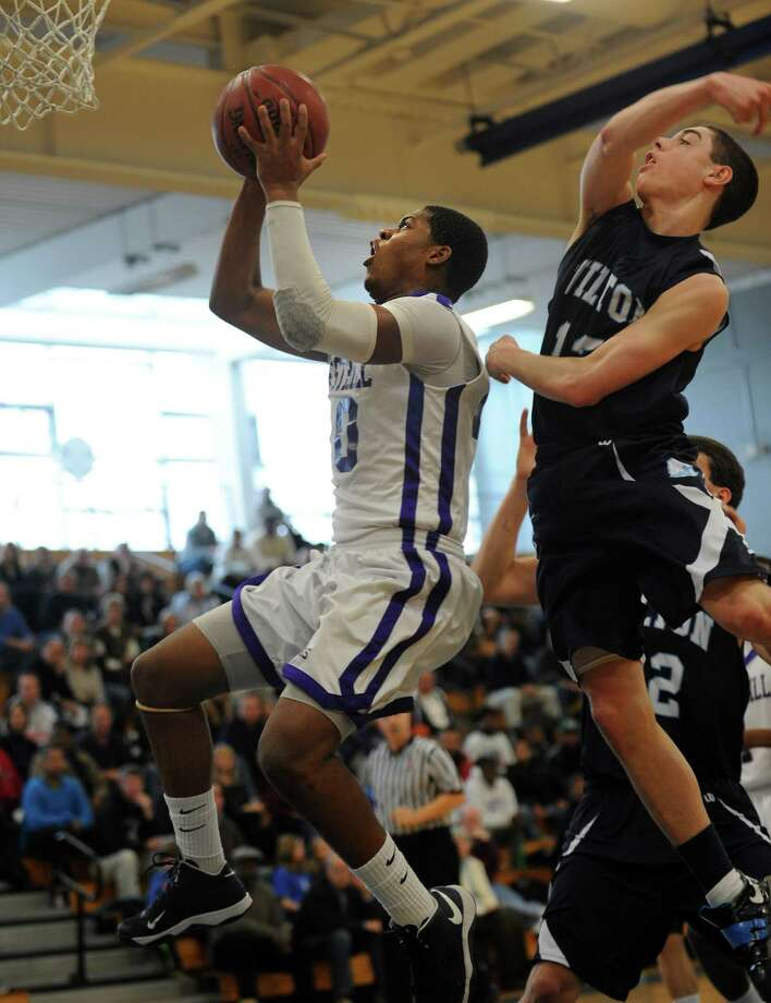 Westhill's Yveson Cassamajor puts up the ball as Wilton's Richard Williams defends during the FCIAC boys' basketball quarterfinals Saturday, Feb. 23, 2013 at Fairfield Ludlowe High School in Fairfield, Conn. Photo: Autumn Driscoll / Connecticut Post