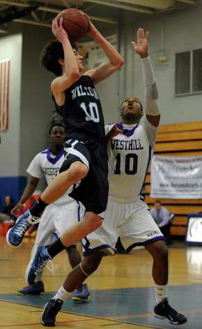 Wilton's Eric Houska puts up the ball as Westhill's Yveson Cassamajor defends during the FCIAC boys' basketball quarterfinals Saturday, Feb. 23, 2013 at Fairfield Ludlowe High School in Fairfield, Conn. Photo: Autumn Driscoll / Connecticut Post