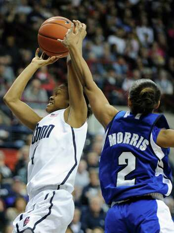 Connecticut's Moriah Jefferson, left, is fouled by Seton Hall's Brittany Morris during the second half of an NCAA college basketball game in Storrs, Conn., Saturday, Feb. 23, 2013. Connecticut won the game 90-30. (AP Photo/Fred Beckham) Photo: Fred Beckham, Associated Press / Associated Press