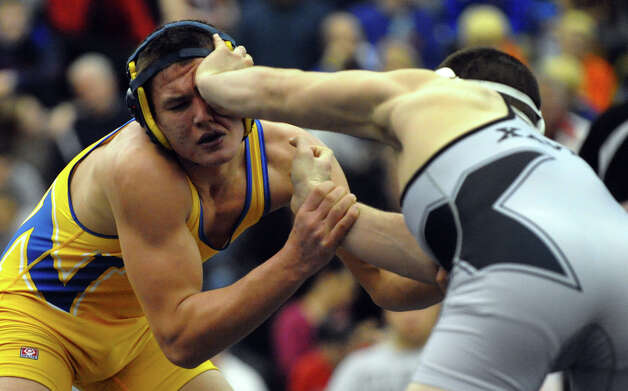 State open championship wrestling action at Hillhouse High School in New Haven, Conn. on Saturday February 23, 2013. Photo: Christian Abraham / Connecticut Post