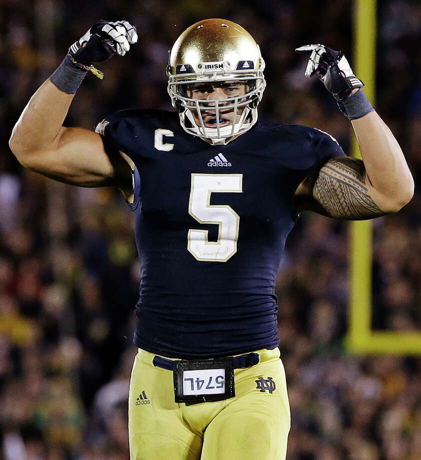 In this Sept. 22, 2012, file photo, Notre Dame linebacker Manti Te'o reacts following a tackle against Michigan during the second half of an NCAA college football game in South Bend, Ind. With preseason hype pretty much out the window, the Heisman Trophy race starts now and it's about results. The Associated Press takes a look at six players that will be competing for the coveted award presented annually to college football's most outstanding player. (AP Photo/Darron Cummings, File) Photo: Darron Cummings, STF / AP