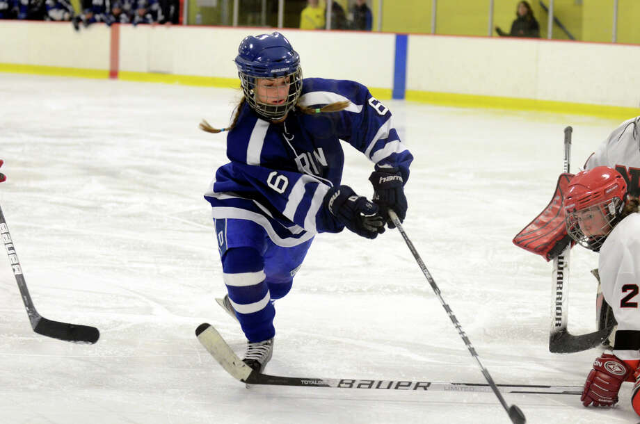 Darien's Marissa Baker (6) controls the puck during the FCIAC girls hockey finals against New Canaan at Terry Conners Rink in Stamford on Saturday, Feb. 23, 2013. Photo: Amy Mortensen / Connecticut Post Freelance