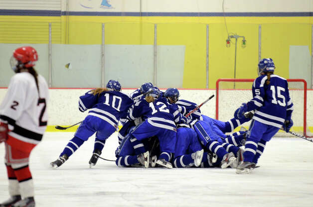 Darien's celebrates on the ice during the FCIAC girls hockey finals against New Canaan at Terry Conners Rink in Stamford on Saturday, Feb. 23, 2013. Photo: Amy Mortensen / Connecticut Post Freelance