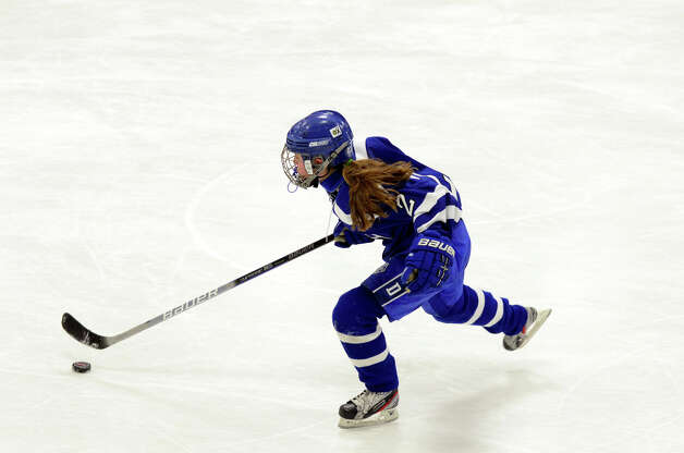 Darien's Georgia Cassidy (2) controls the puck during the FCIAC girls hockey finals against New Canaan at Terry Conners Rink in Stamford on Saturday, Feb. 23, 2013. Photo: Amy Mortensen / Connecticut Post Freelance