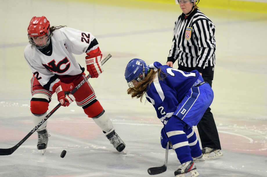 New Canaan's Olivia Hompe (22) and Darien's Georgia Cassidy (2) go after the puck during the FCIAC girls hockey finals at Terry Conners Rink in Stamford on Saturday, Feb. 23, 2013. Photo: Amy Mortensen / Connecticut Post Freelance