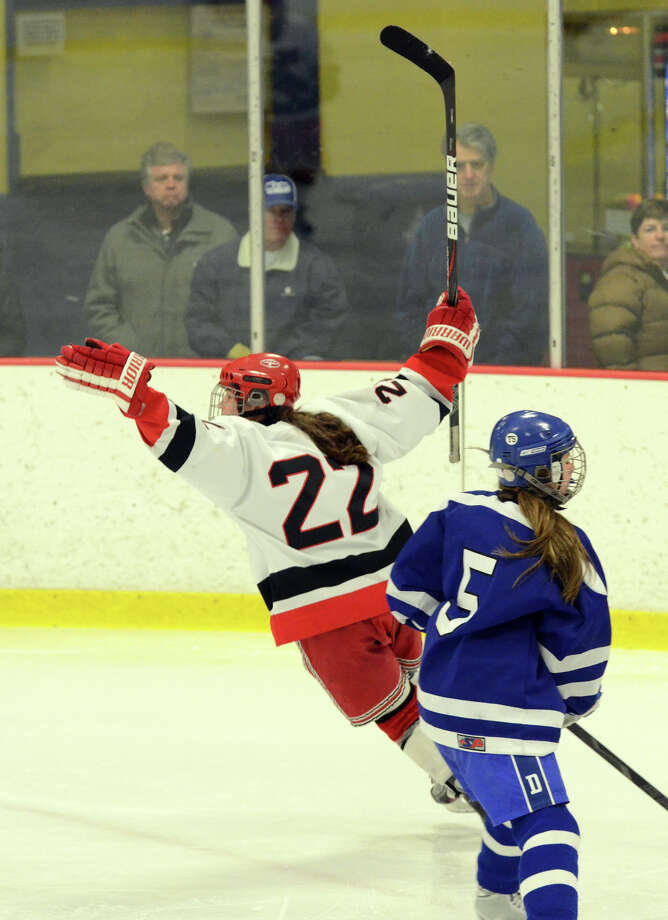 New Canaan's Olivia Hompe (22) celebrates a goal against Darien during the second period of the FCIAC girls hockey finals at Terry Conners Rink in Stamford on Saturday, Feb. 23, 2013. Photo: Amy Mortensen / Connecticut Post Freelance