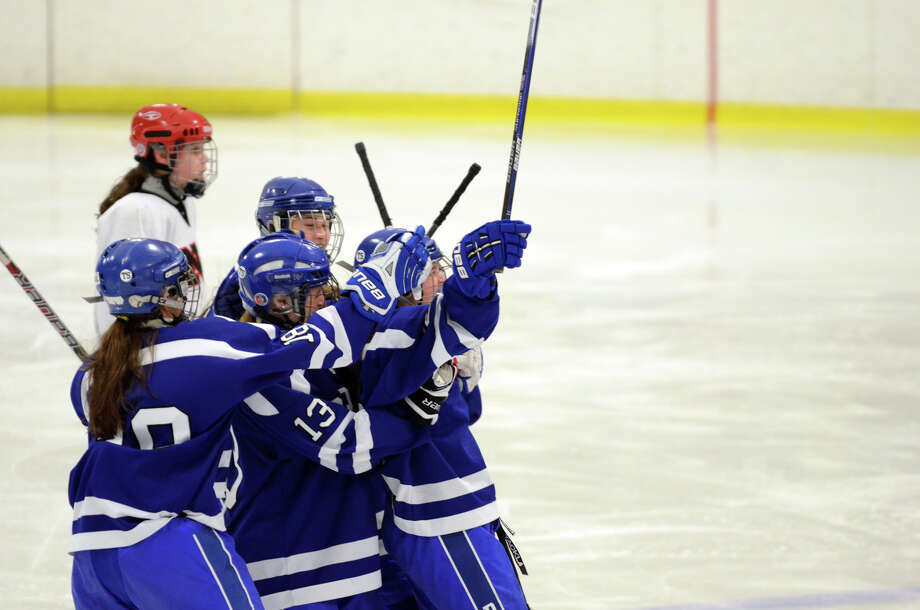 Darien celebrates a goal during the FCIAC girls hockey finals against New Canaan at Terry Conners Rink in Stamford on Saturday, Feb. 23, 2013. Photo: Amy Mortensen / Connecticut Post Freelance