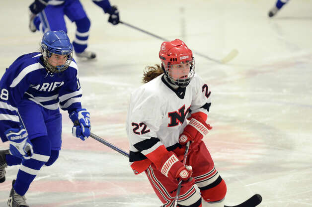 New Canaan's Oliva Hompe (22) on the ice during the FCIAC girls hockey finals against Darien at Terry Conners Rink in Stamford on Saturday, Feb. 23, 2013. Photo: Amy Mortensen / Connecticut Post Freelance