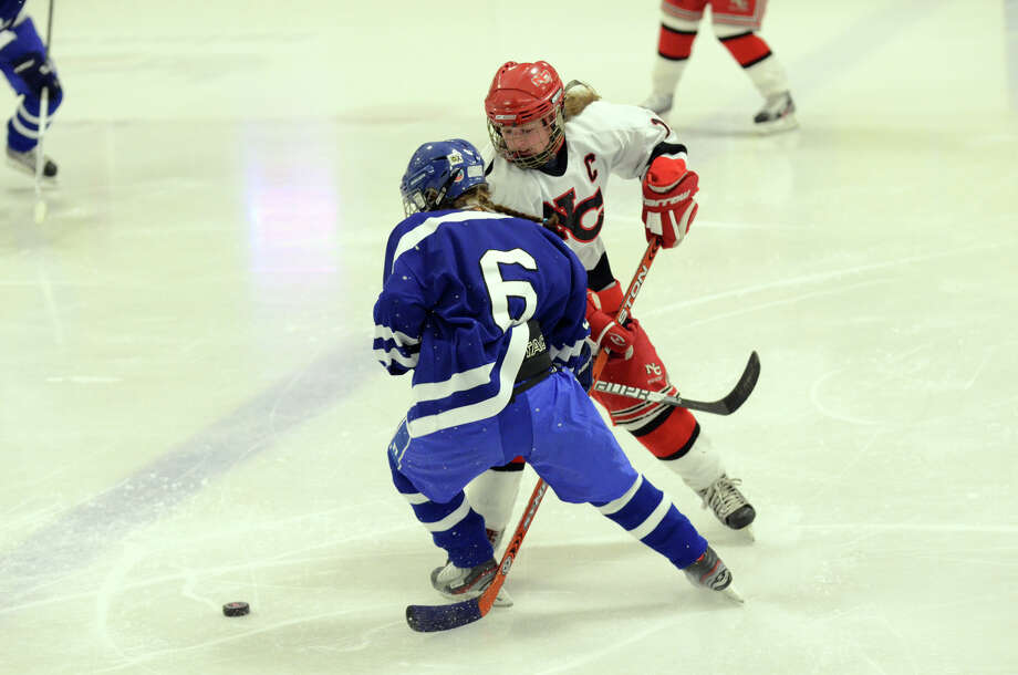 New Canaan's Corbett Ripley (16) and Darien's Marissa Baker (6) go after the puck during the FCIAC girls hockey finals at Terry Conners Rink in Stamford on Saturday, Feb. 23, 2013. Photo: Amy Mortensen / Connecticut Post Freelance