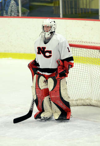 New Canaan's Nathalie Deney (1) protects the goal during the FCIAC girls hockey finals against Darien at Terry Conners Rink in Stamford on Saturday, Feb. 23, 2013. Photo: Amy Mortensen / Connecticut Post Freelance
