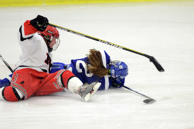 New Canaan's Madzie Carroll (14) and Darien's Georgia Cassidy (2) collide on the ice during the FCIAC girls hockey finals at Terry Conners Rink in Stamford on Saturday, Feb. 23, 2013. Photo: Amy Mortensen / Connecticut Post Freelance