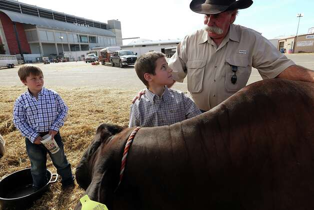 David Jalufka, 62, spent decades with the Department of Public Safety and as Karnes County sheriff. Now he enjoys spending time with his grandsons, 7-year-old Rancher, left, and Utah, 9. Photo: Jerry Lara, Staff / © 2013 San Antonio Express-News