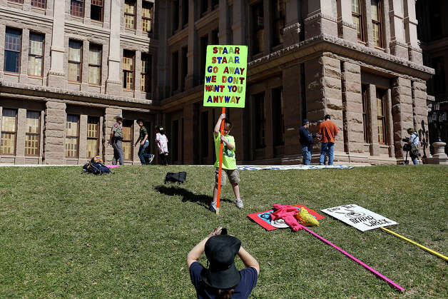 Braden Cotten, 10, of The Woodlands, poses for his mother, Amy Cotten, to take a picture during the Save Texas Schools March and Rally at the Texas State Capitol in Austin on Saturday, Feb. 23, 2013. Photo: Lisa Krantz, San Antonio Express-News / San Antonio Express-News