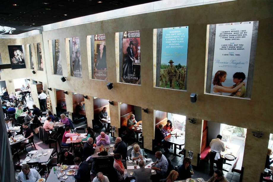 This Thursday, Feb. 21, 2013 photo shows people having lunch beneath Oscar posters at Kate Mantilini restaurant in Beverly Hills, Calif. The 85th Academy Awards are held on Sunday, Feb. 24, 2013, in Los Angeles. (AP Photo/Nick Ut) Photo: Nick Ut