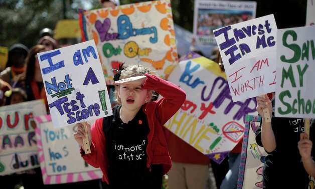 Cate Foughty, 6, of Frisco, Texas, takes part in a rally for Texas public schools at the state Capitol, Saturday, Feb. 23, 2013, in Austin, Texas. About 2,000 teachers, students, parents and school administrators rallied at the state Capitol, demanding that the Legislature reverse $5.4 billion in cuts to public education amid new data that Texas now spends less per-pupil than almost anywhere else in America.(AP Photo/Eric Gay) Photo: Eric Gay, Associated Press / AP