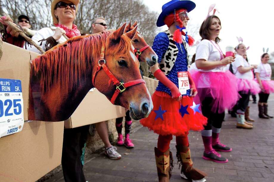 A group of people participate in the costume contest before the 26th annual ConocoPhillips Rodeo Run 5k and 10k that started on Walker Street downtown as part of the Houston Livestock Show and Rodeo festivities Friday, Feb. 22, 2013, in Houston. Photo: Johnny Hanson, Houston Chronicle / © 2013  Houston Chronicle