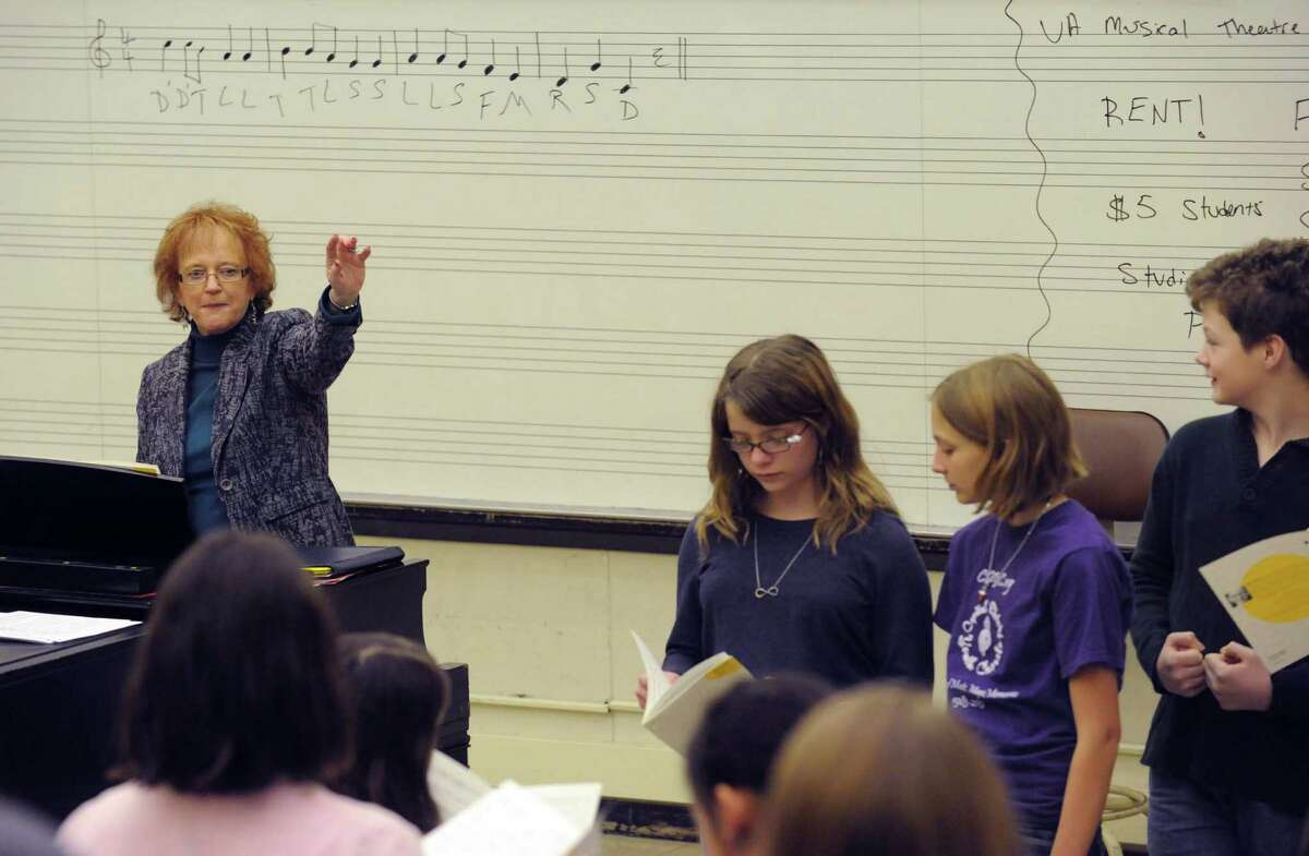 Diane Warner, left, directs members of the Capital District Youth Chorale practice at the UAlbany Performing Arts building on Saturday, Feb.2, 2013, in Albany, N.Y. (Michael P. Farrell/Times Union)