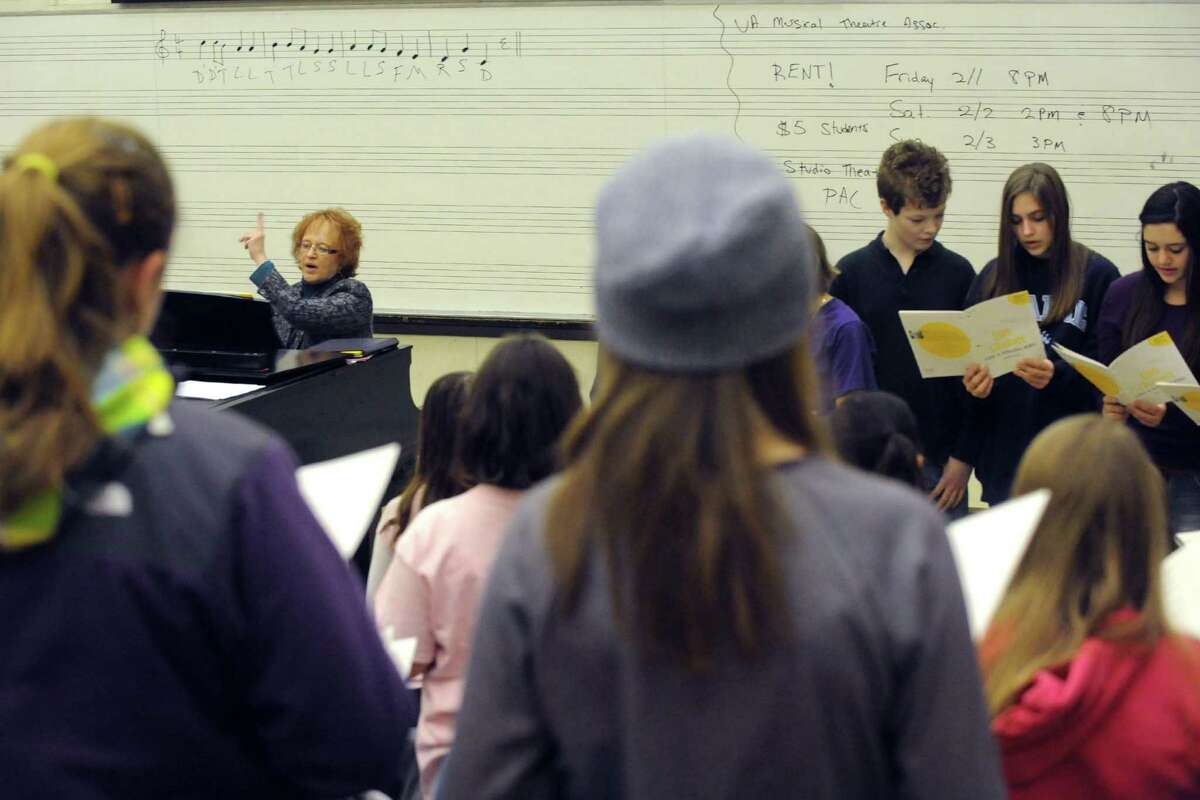 Diane Warner, left, directs members of the Capital District Youth Chorale practice at the UAlbany Performing Arts building on Saturday, Feb. 2, 2013 in Albany, N.Y. (Michael P. Farrell/Times Union)
