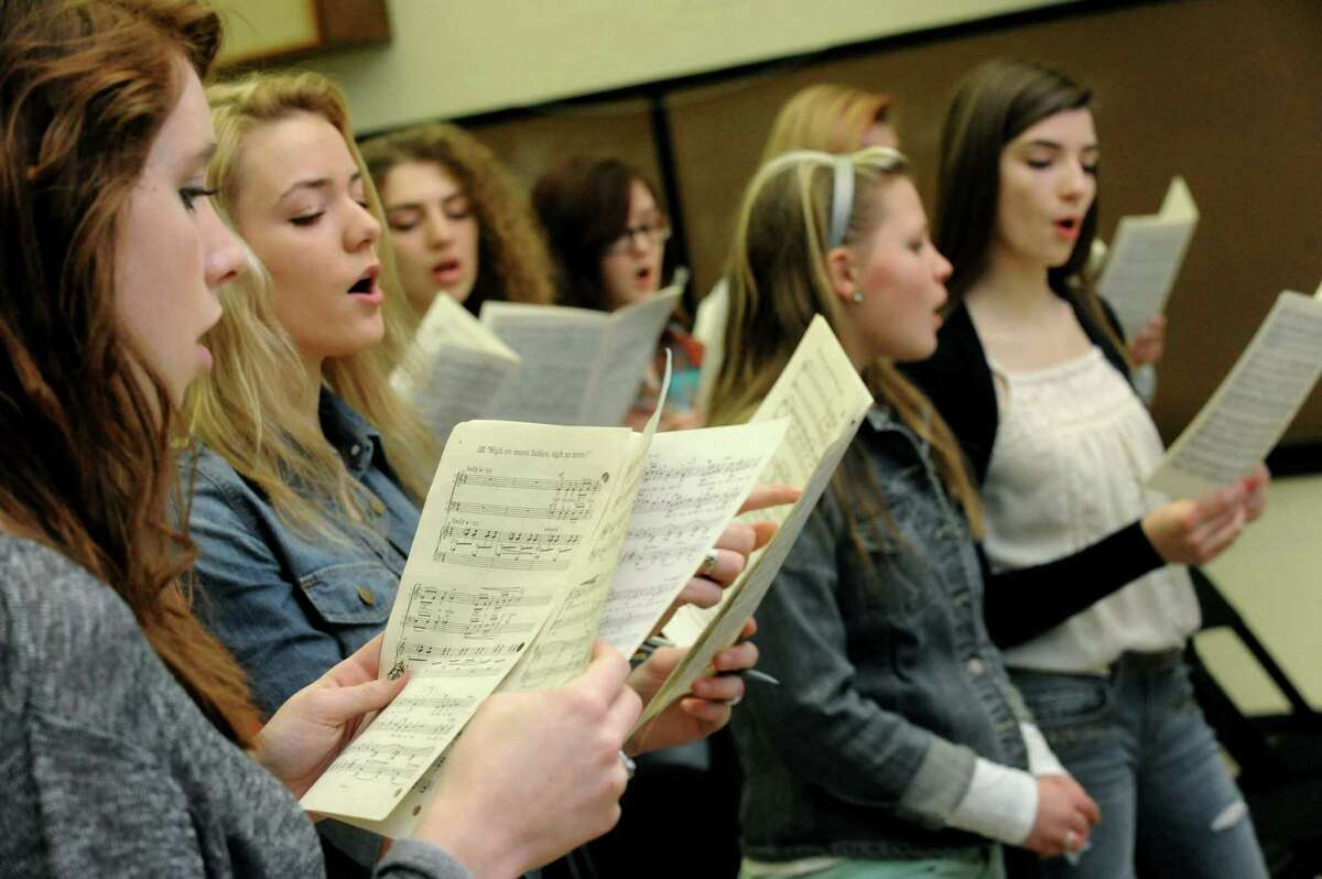 Members of the Capital District Youth Chorale Maddie Hartmann, left, and Cassendra McDonald practice at the UAlbany Performing Arts building on Saturday, Feb. 2, 2013, in Albany, N.Y. (Michael P. Farrell/Times Union)