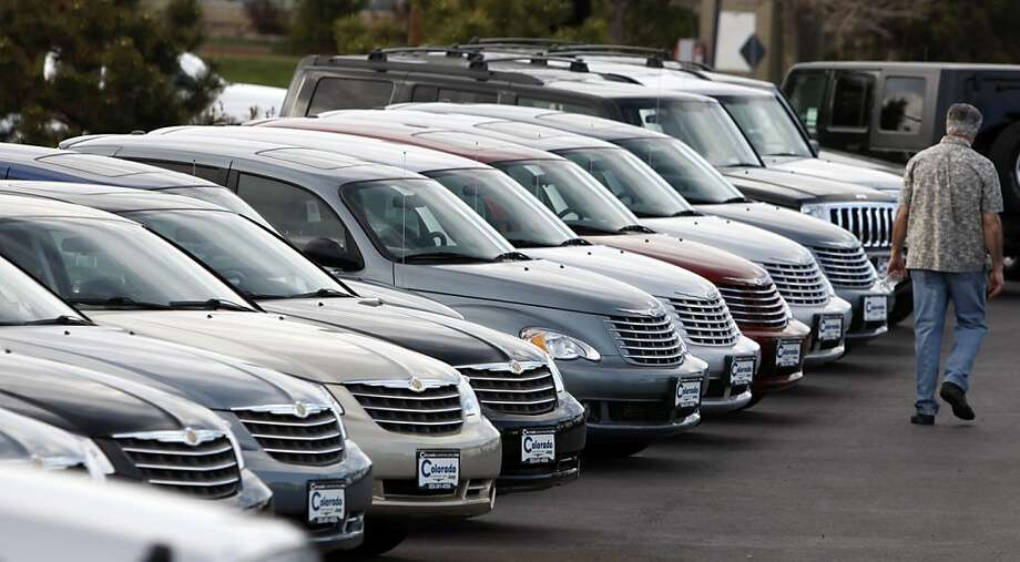 In this April 11, 2010 photo, an unidentified buyer looks over a long row of unsold 2010 Chrysler PT Cruisers at a Chrysler-Jeep dealership in Aurora, Colo.  Chrysler Group LLC lost a staggering $3.8 billion from the time it left bankruptcy protection June 10 through the end of last year, but the automaker says its fortunes improved dramatically in the first quarter. Photo: David Zalubowski, AP