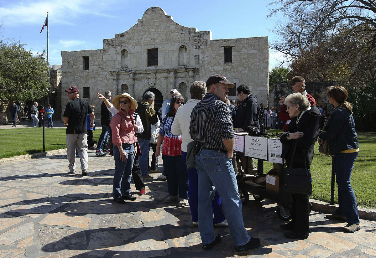 Visitors wait in a line that wrapped around the grounds of the Alamo for an opportunity to see the historic letter.