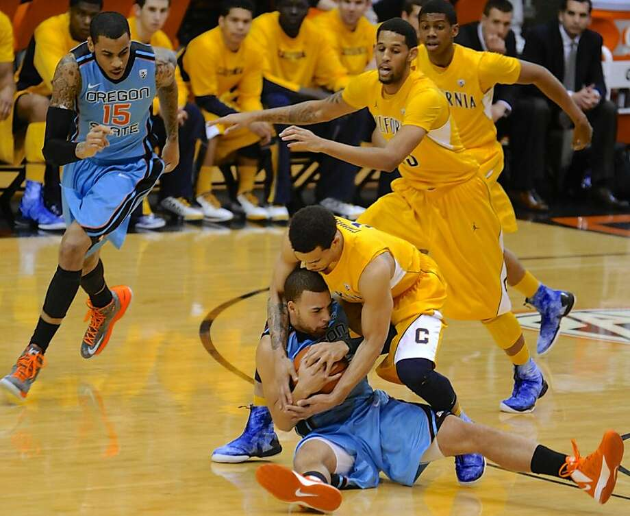 California's Justin Cobbs, top, tussles for the ball with Oregon State's Roberto Nelson during the first half of an NCAA college basketball game in Corvallis, Ore., Saturday, Feb. 23, 2013. (AP Photo/Greg Wahl-Stephens) Photo: Greg Wahl-Stephens, Associated Press