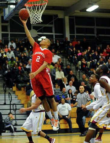 Greenwich's #2C.J. Byrd lays up for two points, during FCIAC boys basketball quarterfinal action against St. Joseph at in Fairfield, Conn. on Saturday February 23, 2013. Photo: Christian Abraham / Connecticut Post