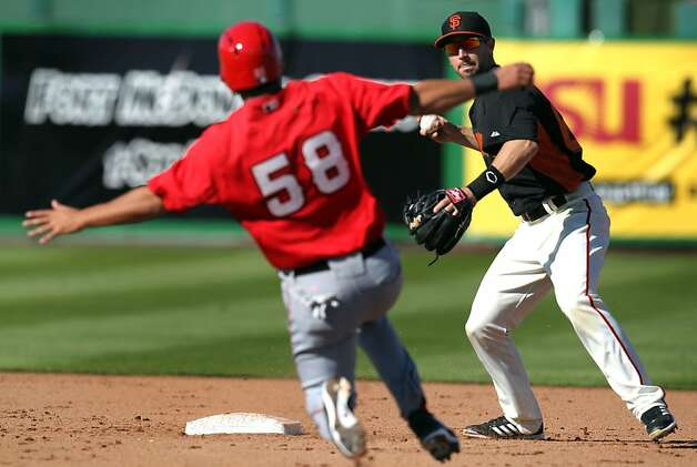 San Francisco Giants infielder Nick Noonan turns the double play to end a Los Angeles Angels treat in the 8th inning of their exhibition spring training baseball game Saturday, Feb. 23, 2013, in Scottsdale, Ariz. Photo: Lance Iversen, The Chronicle