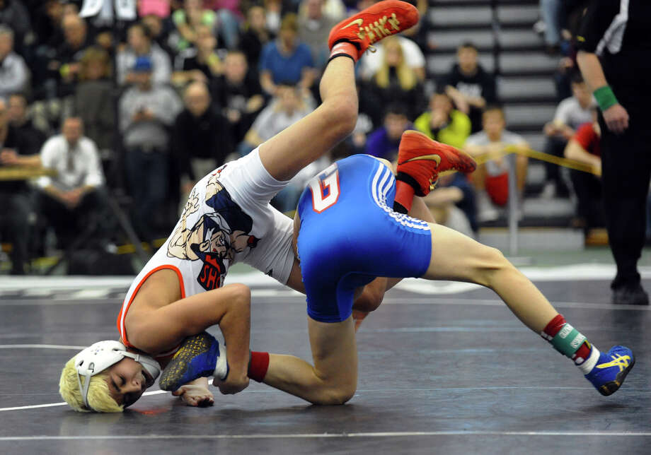 Danbury's Paulo Freitas, left, goes up against Glastonbury's Joseph Rossetti, during state open championship wrestling action at Hillhouse High School in New Haven, Conn. on Saturday February 23, 2013. Photo: Christian Abraham / Connecticut Post