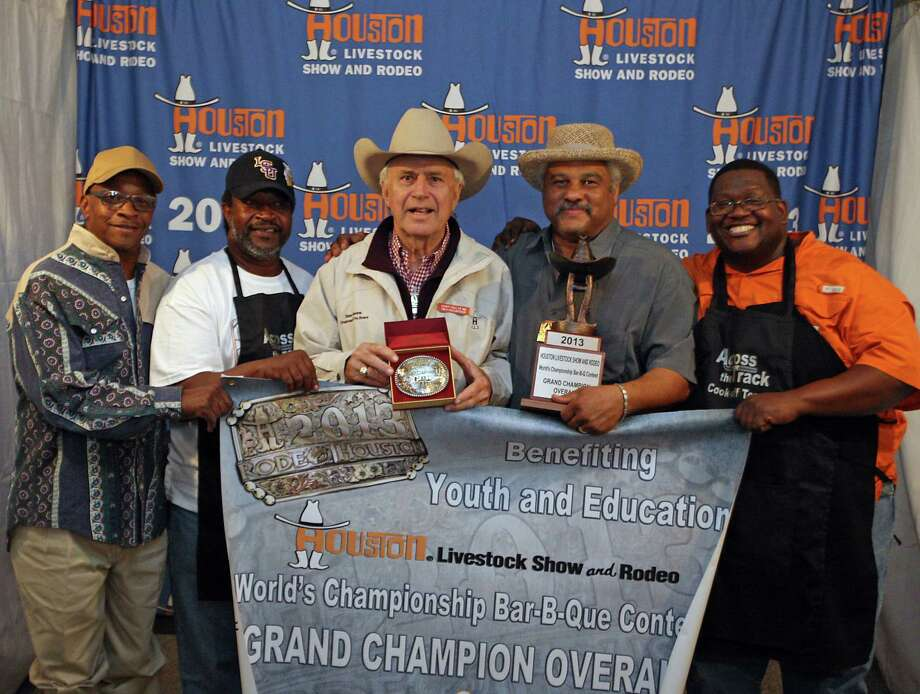 """Across the Track Cook-off Team"" from left, Larry Gipson, Kerry Fellows, with Houston Livestock Show and Rodeo Chairman Steve Stevens center, Roy Owens and Dana Dutton right, pose for a photograph after winning the Overall Grand Champion and Champion Ribs at the Houston Livestock Show and Rodeo World's Championship Bar-B-Que Contest in Reliant Park Saturday, Feb. 23, 2013, in Houston. Photo: James Nielsen, Houston Chronicle / © 2013  Houston Chronicle"
