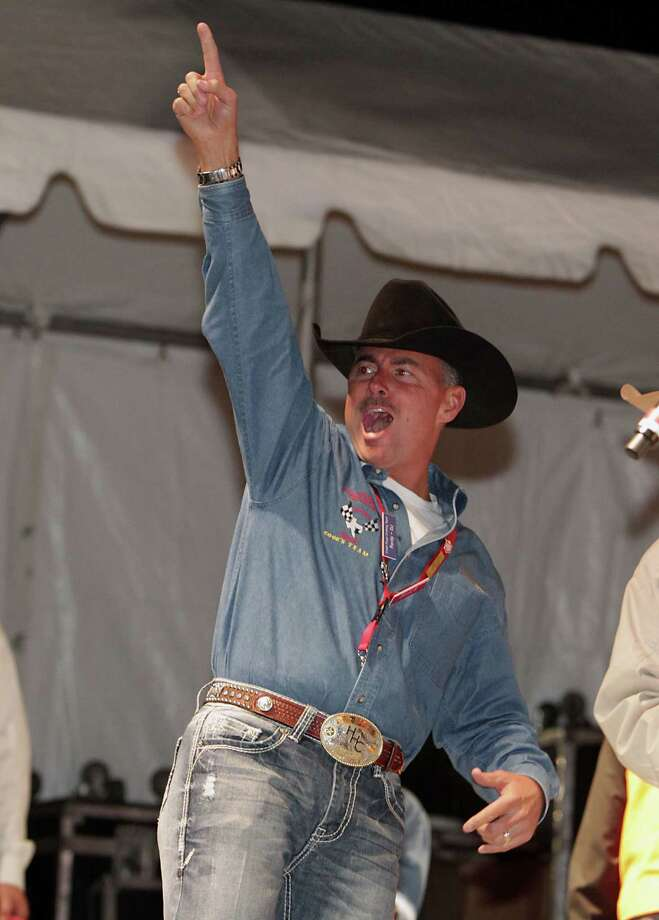"Randy Ritch with team "" Red's Young Guns"" celebrates after the team was announced the chicken division winner at the Houston Livestock Show and Rodeo World's Championship Bar-B-Que Contest in Reliant Park Saturday, Feb. 23, 2013, in Houston. Photo: James Nielsen, Houston Chronicle / © 2013  Houston Chronicle"