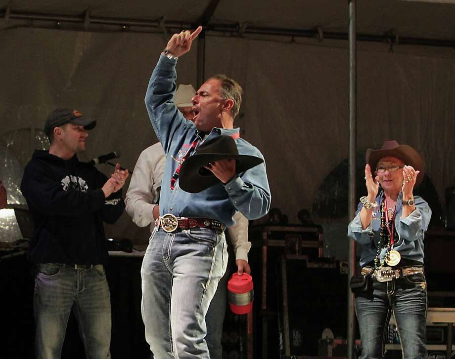 """Randy Ritch with team """" Red's Young Guns"""" celebrates after the team was announced the chicken division winner at the Houston Livestock Show and Rodeo World's Championship Bar-B-Que Contest in Reliant Park Saturday, Feb. 23, 2013, in Houston. Photo: James Nielsen, Houston Chronicle / © 2013  Houston Chronicle"""