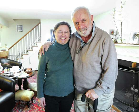 Gilbert Heller with his wife Zdena in their Greenwich home, Friday afternoon, Feb. 15, 2013. Gilbert has Parkinson's disease and both he and his wife use the services of helpers provided through At Home in Greenwich, a nonprofit, nonsectarian organization founded to help senior residents of Greenwich with access to life services and to a network of social connections and events. Photo: Bob Luckey / Greenwich Time