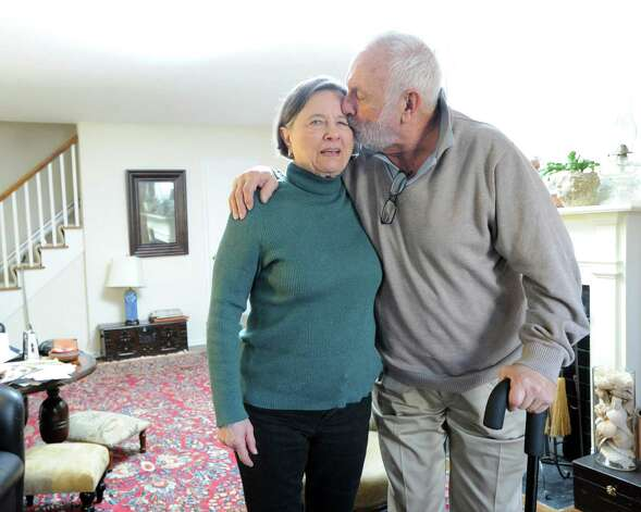Gilbert Heller gives a kiss to his wife Zdena at their Greenwich home, Friday afternoon, Feb. 15, 2013. Gilbert Heller has Parkinson's disease and both he and his wife use care giver services provided through At Home in Greenwich, a nonprofit, nonsectarian organization founded to help senior residents of Greenwich with access to life services and to a network of social connections and events. Photo: Bob Luckey / Greenwich Time