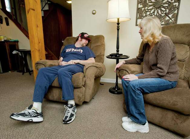 Gary Sand, 33, of Danbury, was in a rollover car accident 11 years ago that caused significant brain stem injury. He sits in his room at his home in Danbury with his mother Margaret Sand. Saturday, Feb. 2, 2013 Photo: Scott Mullin