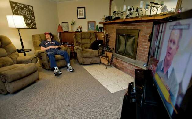 Gary Sand, 33, of Danbury, was in a rollover car accident 11 years ago that caused significant brain stem injury. He sits in his room at his home in Danbury. Saturday, Feb. 2, 2013 Photo: Scott Mullin / The News-Times Freelance