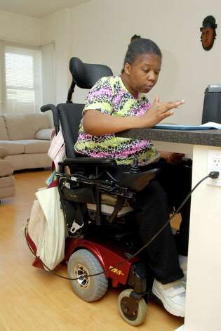 Veronica Brown at home in her apartment in Stamford, Conn. on Friday February 15, 2013. Brown suffered a stroke a couple of years ago and after living in a nursing home for awhile is able to live at home with help. Photo: Dru Nadler / Stamford Advocate Freelance