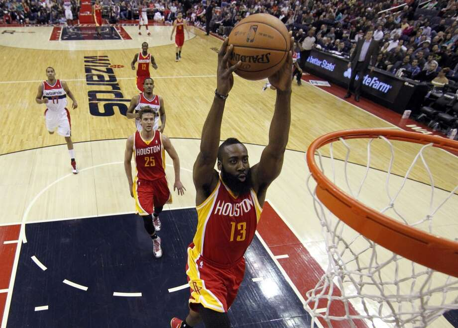 Feb. 23: Wizards 105, Rockets 103Rockets guard James Harden dunks, with forward Chandler Parsons following.