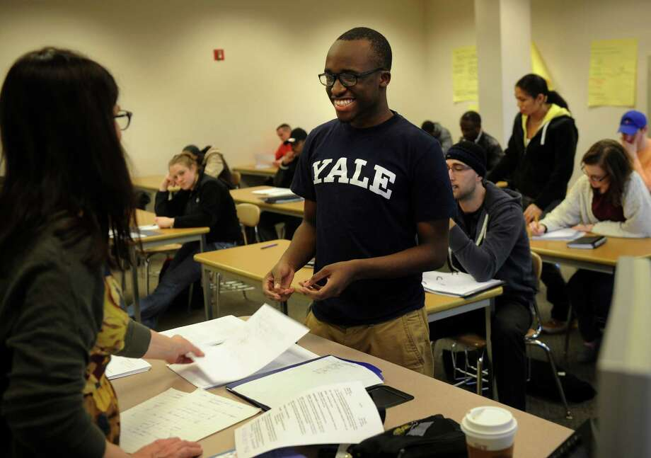 Central High student Jean Joseph, of Bridgeport, turns in a quiz to his professor, Annmarie Kennedy, in his pre-calculus class at Housatonic Community College in Bridgeport on Thursday, January 31, 2013. Photo: Brian A. Pounds