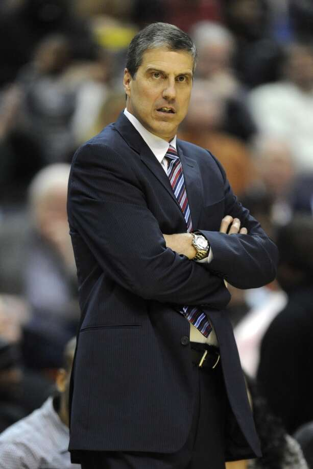 Wizards head coach Randy Wittman looks on.