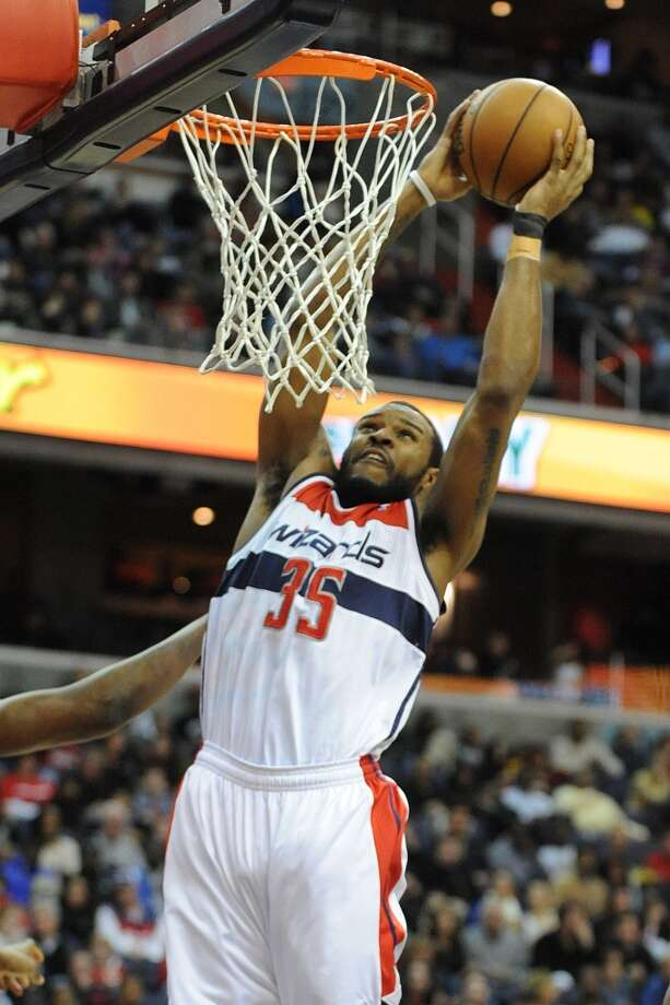 Wizards power forward Trevor Booker goes for a dunk.